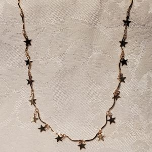 Gold multi star necklace